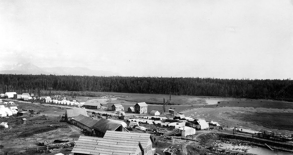 View of the temporary railroad construction town consisting of tents and a few buildings along Ship Creek in Anchorage, Alaska, 1915.  The Montana Pool Room is visible near the left edge of the image. This image was probably taken within a few days of Capps arrival in Anchorage on June 14, 1915.  Photo by S.R. Capps, 1915, U.S Geological Survey Photo Library. (S.R. Capps, U.S. Geological Survey Photo Library)