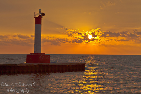 A beautiful sunrise over Lake Ontario in Oakville at the Lighthouse pier (Ian C Whitworth)