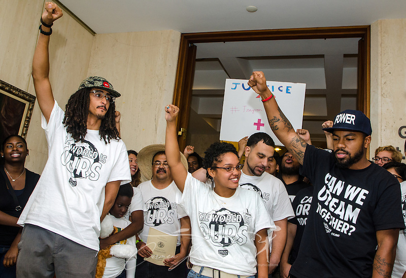 Members of the Dream Defenders, including Melanie Andrade (center) and Phillip Agnew (right), raise their fists in solidarity following a press conference July 23, 2013 at the Florida state capitol in Tallahassee. The youth-led activist group has occupied the capitol since July 16, 2013, demanding that Gov. Rick Scott call a special legislative session to address issues like racial profiling, the school-to-prison pipeline, and Florida's stand-your-ground law. (Photo by Carmen K. Sisson/Cloudybright) (Carmen K. Sisson/Cloudybright)