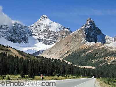 See Mount Athabasca (left, 3491 meters or 11,453 feet) from Icefields Parkway near Sunwapta Pass in Banff National Park, Alberta, Canada. This is part of the big Canadian Rocky Mountain Parks World Heritage Site declared by UNESCO in 1984. (© Tom Dempsey / PhotoSeek.com)