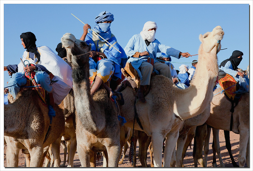 Group of nomads on dromedaries in M'hamid, Morocco. (Rosa Frei)