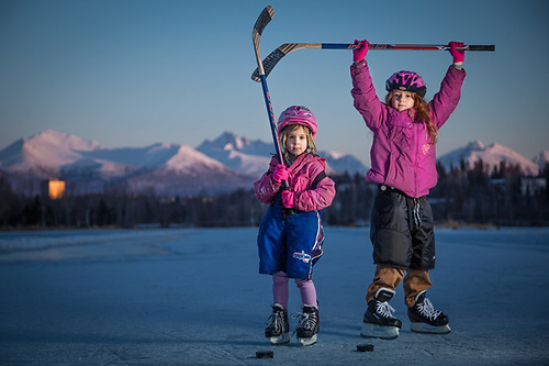 "Sisters Kavina (5) and Zakara (8) at Westchester Lagoon, Anchorage.  ""With the lack of snow this year, we needed to find an alternative to downhill skiing.  So, to get the girls out of the house, we started skating.  They love it!""  -John Baumeister (© Clark James Mishler)"