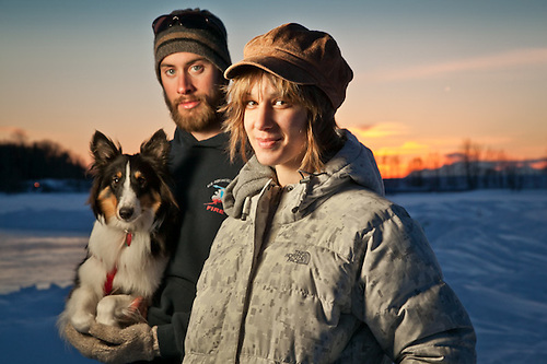 Rena McDonell and Dane Ketner with their one year old sheltie, Ella, Westchester Lagoon, Anchorage. (Clark James Mishler)