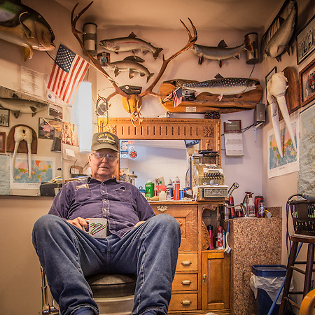 "Vernon Hurlbert at the Bushpilots Barbershop, Anchorage International Airport.  ""This might be the most photographed barbershop in America""  -Vernon Hurlbert   vernonhurlbert@hotmail.com (© Clark James Mishler)"