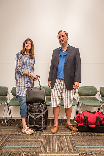 """We're going to a wedding and Jim needed to bring a jacket...he decide to wear it.""  Nancy and Jim Brush repair to board their flight at the Santa Rosa Airport. (Clark James Mishler)"