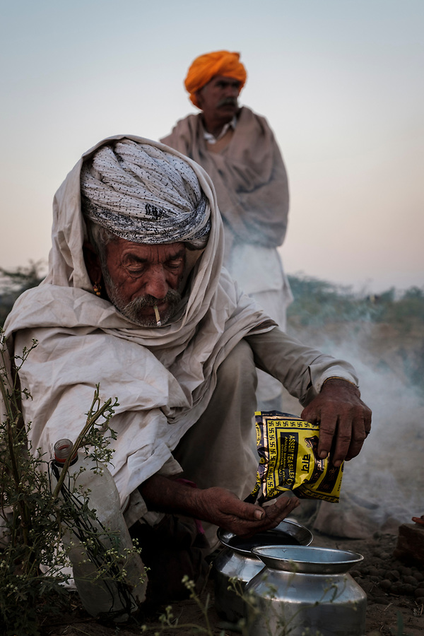 PUSHKAR, INDIA - CIRCA NOVEMBER 2016: Camel herder preparing tea early morning in the Pushkar Camel Fair grounds. It is one of the world's largest camel fairs. Apart from the buying and selling of livestock, it has become an important tourist attraction. (Daniel Korzeniewski)