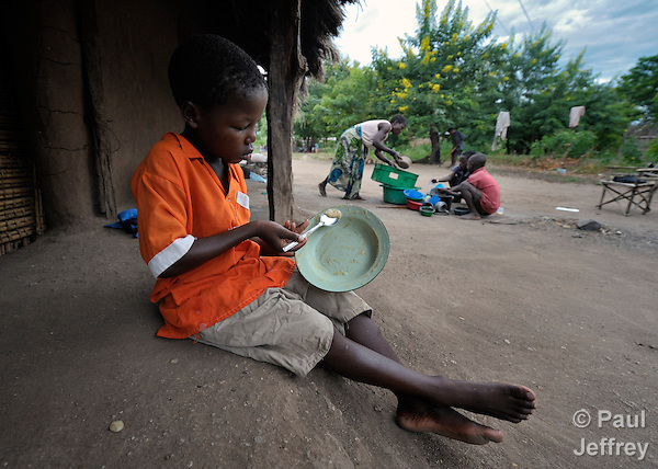 Gota Dzongololo, 11, eats sorghum porridge in the morning after getting dressed in his school uniform. He lives in Chidyamanga, a village in southern Malawi that has been hard hit by drought in recent years, leading to chronic food insecurity, especially during the