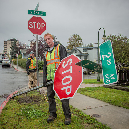 Sub contractors Tom March and Jacob Thompson change out stop signs on 2nd Avenue in downtown Anchorage  alaska_rebel89@yahoo.com (© Clark James Mishler)