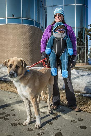 Shannon Donovan with her 10 month old son, Clyde, and her dog, Jack, outside the midtown post office. (Clark James Mishler)