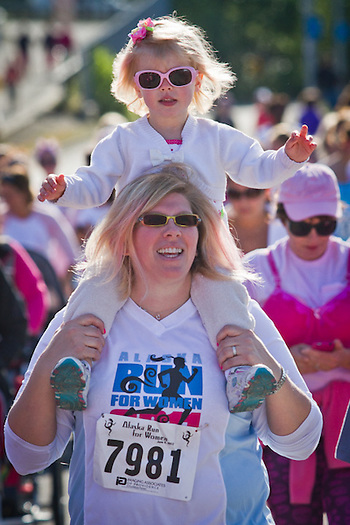 Two year old Reilly Cooper on the shoulders of her mother, Dana, at the Alaska Run for Women, Anchorage (Clark James Mishler)