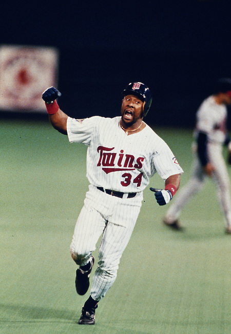 MINNEAPOLIS, MN-OCTOBER 26: MLB Hall of Fame outfielder Kirby Puckett rounds the bases after hitting a game winning, walk off home run in the eleven inning off of Charlie Leibrant to win Game 6 of the 1991 World Series against the Atlanta Braves at The Metrodome on October 26, 1991 in Minneapolis, Minnesota. The Twins won 4-3 and tied the series 3-3.  (Photo by Ron Vesely) (Ron Vesely)