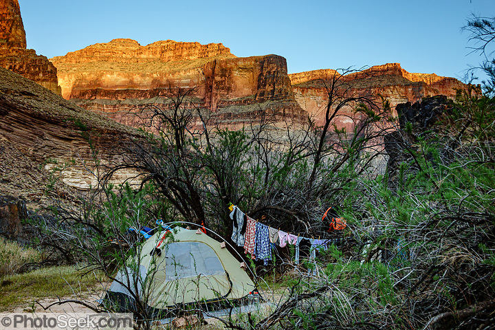 Tent & laundry line at Hundred and Twenty Mile Camp at Colorado River Mile 120.3 (also named Michael Jacobs Camp for an old guide who died here). Day 8 of 16 days rafting 226 miles down the Colorado River in Grand Canyon National Park, Arizona, USA. (© Tom Dempsey / PhotoSeek.com)
