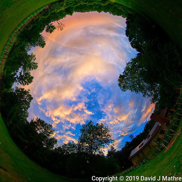 Inverse Little Planet View of an Evening Rainbow. After the Thunderstorm. Composite of 46 images taken with a Nikon D810a camera and 8-15 mm fisheye lens (ISO 200, 8 mm, f/8, 1/200 sec). Raw images processed with Capture One Pro and AutoPano Giga. (DAVID J MATHRE)