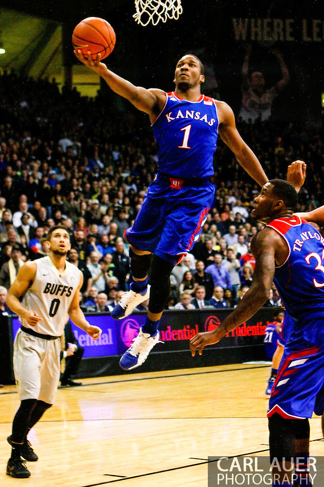 December 7th, 2013:  Kansas Jayhawks freshman guard Wayne Selden, Jr. (1) finger rolls a shot up in the first half of the NCAA Basketball game between the Kansas Jayhawks and the University of Colorado Buffaloes at the Coors Events Center in Boulder, Colorado (Carl Auer/ZUMAPRESS.com)