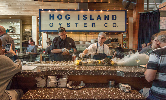 Oyster shuckers at Hog Island Oyster Co. at the Oxbow Market in Napa (Clark James Mishler)