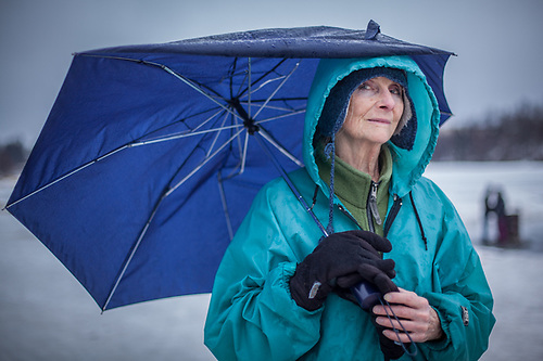 Piano teacher Joan Lindemuth braves rain and unseasonably warm tempertures near Westchester Lagoon, Anchorage. (© Clark James Mishler)