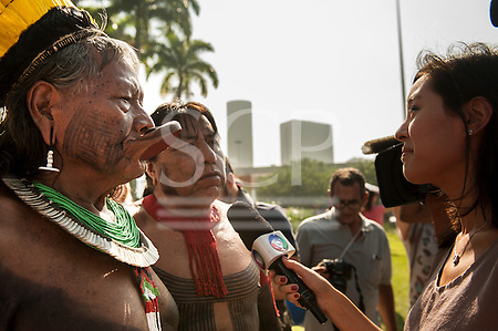 Rio de Janeiro, Brazil. Kayapo Chiefs Raoni and Megaron talk to an International television reporter at the People's Summit, United Nations Conference on Sustainable Development (Rio+20), Rio de Janeiro, Brazil, 15th June 2012. Photo © Sue Cunningham. (Sue Cunningham/SCP)