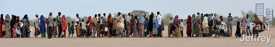 Newly arrived Somali refugees wait in line to register at the Dadaab camp in northeastern Kenya. Swelled with tens of thousands of recent arrivals fleeing drought in Somalia, the camp has had difficulties absorbing the recent arrivals.