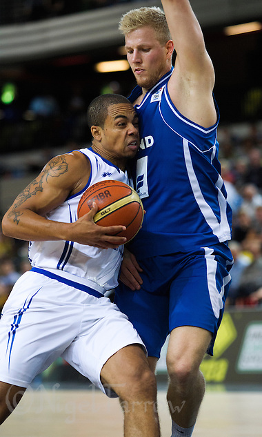 20 AUG 2014 - LONDON, GBR - Devan Bailey (GBR) (left) from Great Britain finds his path to Iceland's net blocked during the men's 2015 EuroBasket 3rd Qualifying Round game against Iceland at the Copper Box Arena in the Queen Elizabeth Olympic Park in Stratford, London, Great Britain (PHOTO COPYRIGHT © 2014 NIGEL FARROW, ALL RIGHTS RESERVED) (NIGEL FARROW/COPYRIGHT © 2014 NIGEL FARROW : www.nigelfarrow.com)