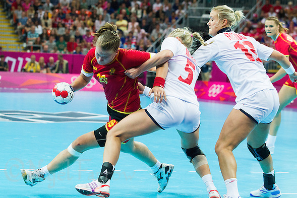 11 AUG 2012 - LONDON, GBR - Suzana Lazovic (MNE) (left) of Montenegro finds her path to goal blocked by Ida Alstad (NOR) (second from left) of Norway during the women's London 2012 Olympic Games handball final at the Basketball Arena in the Olympic Park, in Stratford, London, Great Britain .(PHOTO (C) 2012 NIGEL FARROW) (NIGEL FARROW/(C) 2012 NIGEL FARROW)