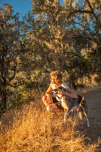 Mitzi Mishler with her dog Molly at sunset near the start of the Oak Hill Trail in Calistoga (Clark James Mishler)