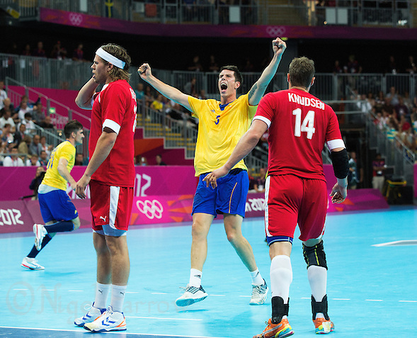 08 AUG 2012 - LONDON, GBR - Kim Andersson (SWE) of Sweden (centre) celebrates a goal during the men's London 2012 Olympic Games quarter final match against Denmark at the Basketball Arena in the Olympic Park, in Stratford, London, Great Britain .(PHOTO (C) 2012 NIGEL FARROW) (NIGEL FARROW/(C) 2012 NIGEL FARROW)