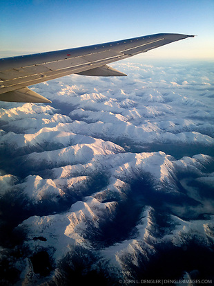 Sunrise on coastal mountains seen from Alaska Airlines flight from Seattle to Juneau in southeast Alaska. SPECIAL NOTE: iPhone photo (John L. Dengler)