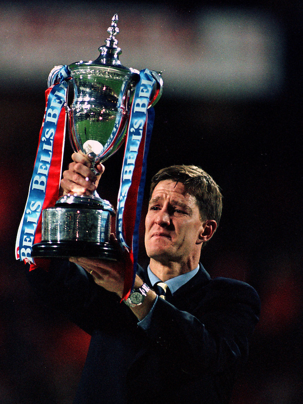 7TH MAY 1997, AN EMOTIONAL RICHARD GOUGH LIFTS THE SCOTTISH PREMIER LEAGUE TROPHY AS RANGERS RECORD THEIR NINTH TITLE IN A ROW, ROB CASEY PHOTOGRAPHY (ROB CASEY/ROB CASEY PHOTOGRAPHY)
