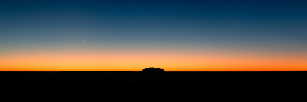 Silhouette of Uluru with clear sky at sunrise (Mark Eden)