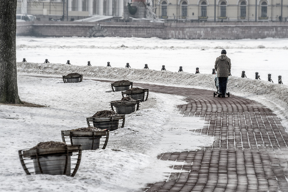 ST. PETERSBURG - CIRCA MARCH 2013: People walking in Zayachy Island, Saint Petersburg, circa March 2013. This is a popular tourist destination with 221 museums, 2000 libraries, and 80  plus theaters within the city. (Daniel Korzeniewski)