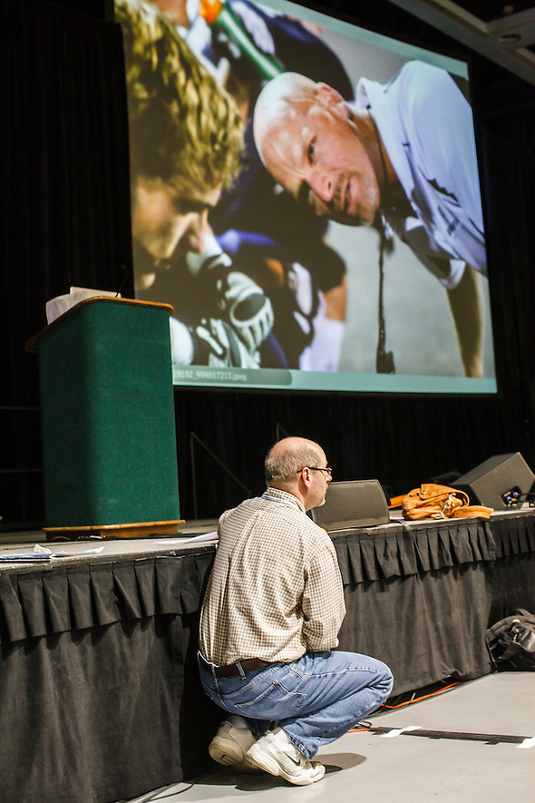 At the 2012 Spring JEA Convention in Seattle, Mark Murray assists with the Photography Critique at the Seattle, Washington State Convention Center. (bryan farley)