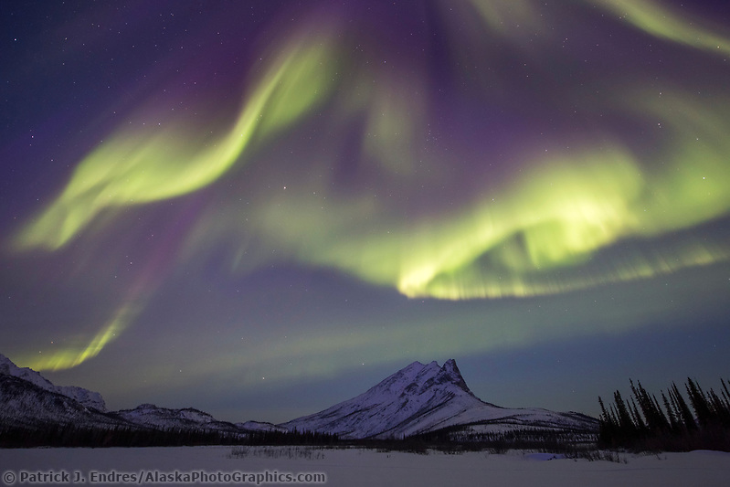 Aurora dances over Sukakpak mountain in the Brooks Range in Alaska's arctic. (Patrick J Endres / AlaskaPhotoGraphics.com)