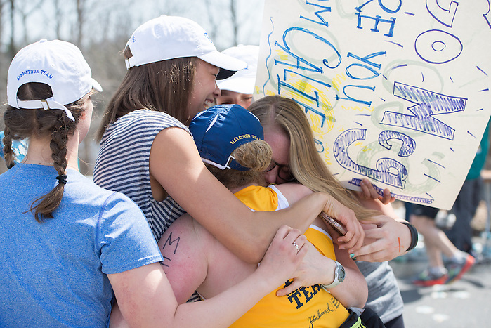 4/18/16 – Natick, MA – Meg Nichols (LA'16) is embraced by friends at Mile 9 of the 2016 Boston Marathon in Natick, MA on April 18, 2016. (Sofie Hecht / The Tufts Daily) (Sofie Hecht / The Tufts Daily)