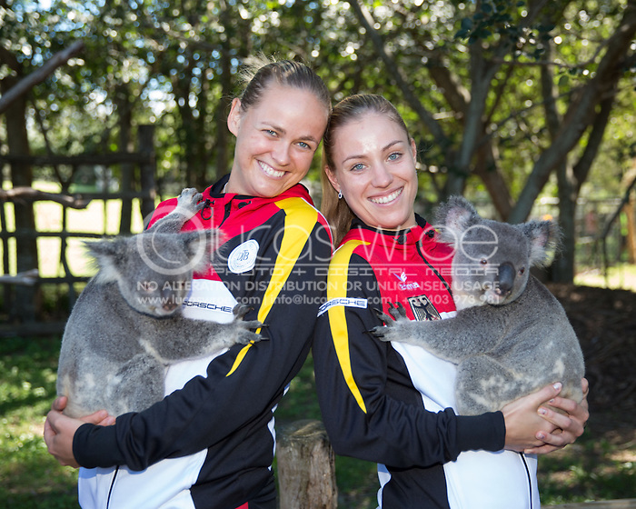 Anna-Lena Groenefeld (GER) and Angelique Kerber (GER), April 18, 2014 - TENNIS : Fed Cup, Semi-Final, Australia v Germany. Lone Pine Koala Sanctuary, Brisbane, Queensland, Australia. Credit: Lucas Wroe (Lucas Wroe)