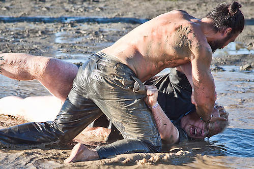 Men wrestling in mud hole, Ninilchik, Alaska (Clark James Mishler)