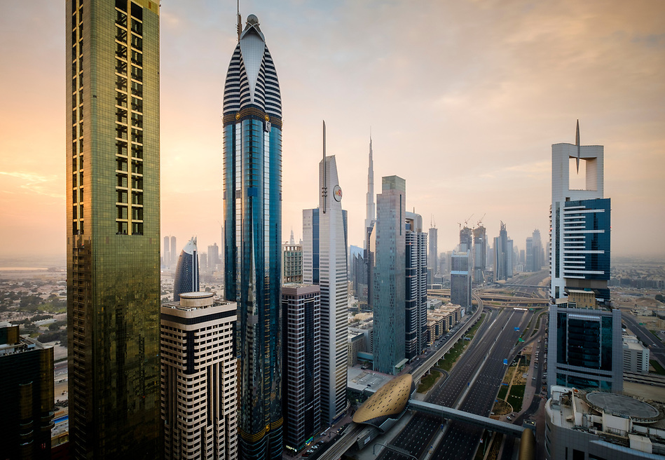 UNITED ARAB EMIRATES, DUBAI - CIRCA JANUARY 2017: Sheikh Zayed Road at sunrise in Dubai. This is the main artery of the city and is home for most of the Dubai skyscrapers. (Daniel Korzeniewski)