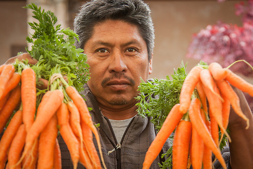 "Gilroy farmer Jose Nunez at the Saturday Market in Calistoga  ""We get up at 4 AM and drive three hours to get here each Saterday morning."" (Clark James Mishler)"