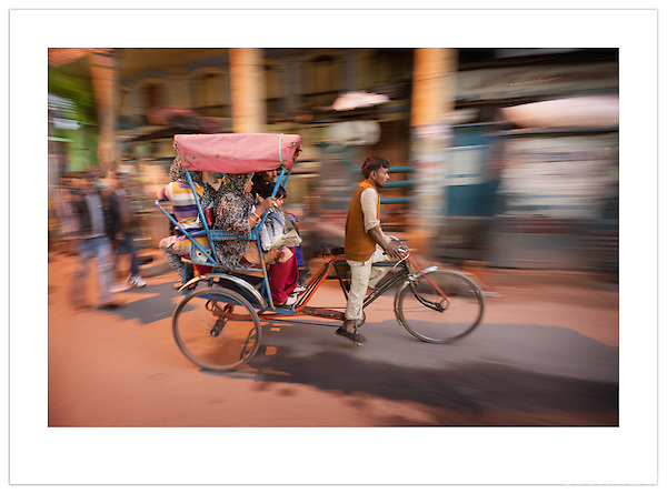 A bicycle rickshaw passing through Chandni Chowk, Old Delhi, India (2013 Ian Mylam)