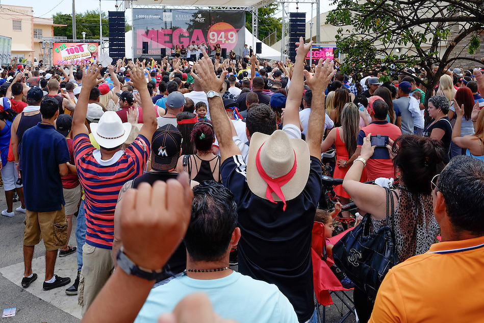 MIAMI - MARCH 9, 2014: People enjoys of the many live performances at one of the stages during the 37th Calle Ocho festival, an annual event that takes place over Eighth Street in Little Havana featuring plenty of music, food, and  it is the biggest party in town that celebrates hispanic heritage. (Daniel Korzeniewski)