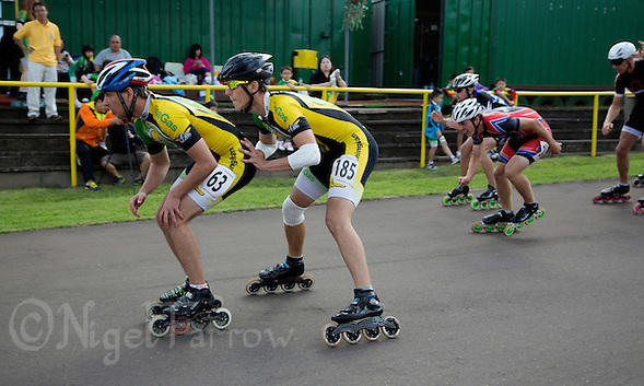 11 AUG 2013 - BIRMINGHAM, GBR - Ben Coole-Probert  (left) of Birmingham Wheels Roller Speed Club is propelled forward at the changeover by team mate Michal Roman (right) during the Junior and Senior Men's 3000m Relay at the Federation of Inline Speed Skating 2013 British Outdoor Championships at Birmingham Wheels Park in Birmingham, West Midlands, Great Britain (PHOTO COPYRIGHT © 2013 NIGEL FARROW, ALL RIGHTS RESERVED) (NIGEL FARROW/COPYRIGHT © 2013 NIGEL FARROW : www.nigelfarrow.com)