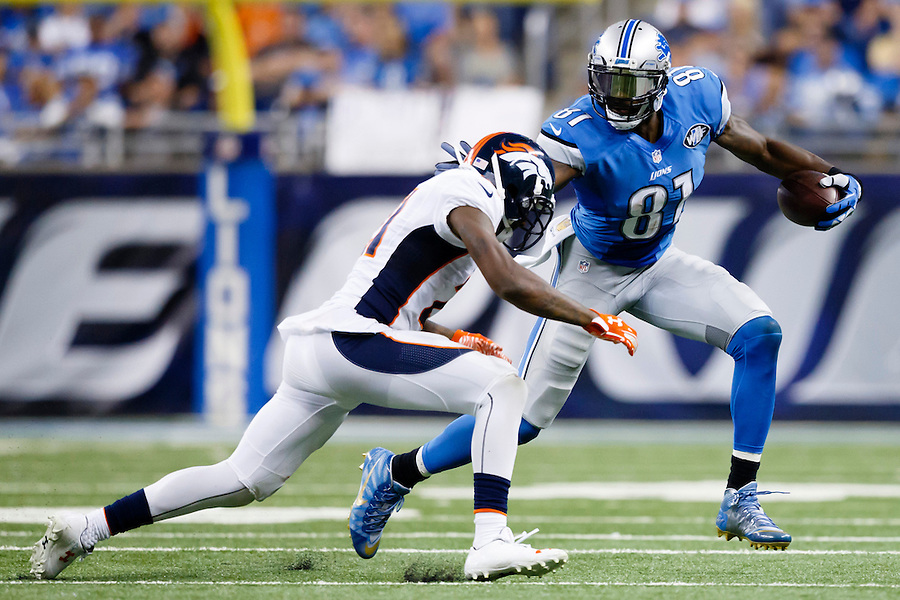 Detroit Lions wide receiver Calvin Johnson (81) runs the ball defended by Denver Broncos cornerback Aqib Talib (21) during an NFL football game at Ford Field in Detroit, Sunday, Sept. 27, 2015. (AP Photo/Rick Osentoski) (Rick Osentoski/AP)