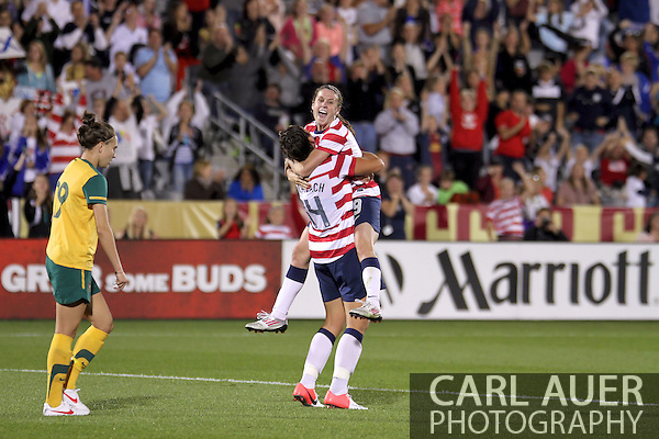 September 19, 2012 Commerce City, CO.  USA m Heather O'Reilly (9) jumps into the arms of Abby Wambach (14) after O'Reilly scored the first goal of the Soccer Match between the USA Women's National Team and the Women's Australian team at Dick's Sporting Goods Park in Commerce City, Colorado (Carl Auer/Cal Sport Media)