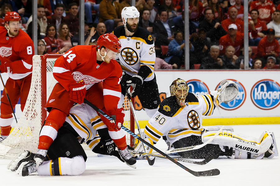 Apr 2, 2015; Detroit, MI, USA; Detroit Red Wings center Gustav Nyquist (14) fight for position with with Boston Bruins defenseman Dennis Seidenberg (44) in front of goalie Tuukka Rask (40) in the first period at Joe Louis Arena. Mandatory Credit: Rick Osentoski-USA TODAY Sports (Rick Osentoski/Rick Osentoski-USA TODAY Sports)