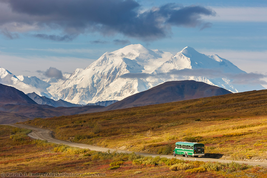 Alaska tourism photos: The north and south summits of Denali are visible from Highway pass as a tour bus travels along the Denali Park road, Denali National Park, Alaska. (Patrick J. Endres / AlaskaPhotoGraphics.com)