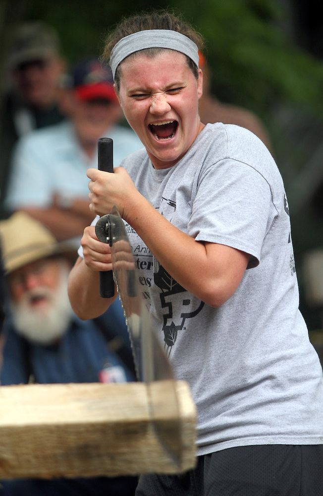 Allison Johnson of Stevens Point, Wisc., celebrates catching a rhythm with her crosscut saw during the wood chopping and sawing contest August 16 at the Iowa State Fair. (Christopher Gannon/The Register)