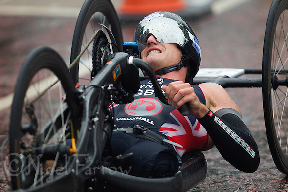 13 SEP 2013 - LONDON, GBR - Joe Townsend (GBR) of Great Britain makes his way round the hand bike course  during the men's TRI-1 category race at the ITU 2013 World Paratriathlon Championships in Hyde Park in London, Great Britain (PHOTO COPYRIGHT © 2013 NIGEL FARROW, ALL RIGHTS RESERVED) (NIGEL FARROW/COPYRIGHT © 2013 NIGEL FARROW : www.nigelfarrow.com)