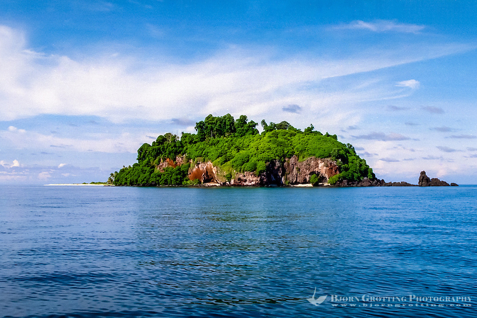Riau Islands, Natuna Islands. Blue skies, a blue ocean and a tropical island. Southwest Natuna. Small island just north of Kalimantan, looking south. (Bjorn Grotting)