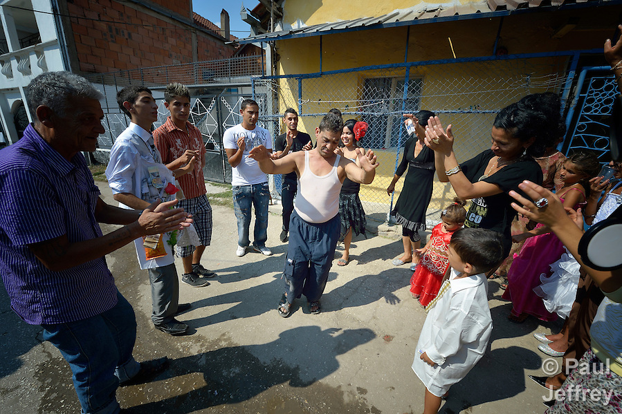 Participants dance in the street during a wedding in Suto Orizari, Macedonia. The mostly Roma community, located just outside Skopje, is considered Europe's largest Roma settlement. . (Paul Jeffrey)