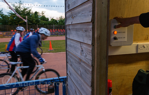 26 MAY 2015 - IPSWICH, GBR - Bill Brooke presses the start gate button to begin a race during a club championship night at Whitton Sports and Community Centre in Ipswich, Suffolk, Great Britain (PHOTO COPYRIGHT © 2015 NIGEL FARROW, ALL RIGHTS RESERVED) (NIGEL FARROW/COPYRIGHT © 2015 NIGEL FARROW : www.nigelfarrow.com)