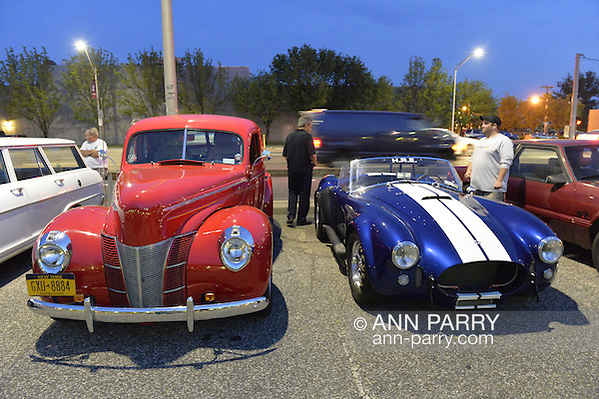 Bellmore, New York, USA. 12th June 2015. A vintage red Ford Deluxe roadster and a classic blue with white striped 437 Cobra racing car are on display at the Friday Night Car Show held at the Bellmore Long Island Railroad Station Parking Lot. Hundreds of classic, antique, and custom cars were on view at the free weekly show, sponsored by the Chamber of Commerce of the Bellmores. (Ann Parry/Ann Parry, ann-parry.com)